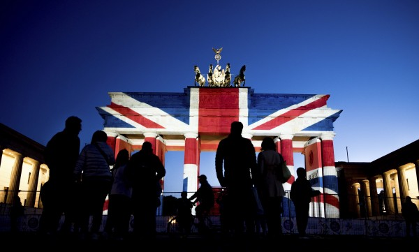 People view the Brandenburg Gate in Berlin after it was illuminated in the colors of the British union flag