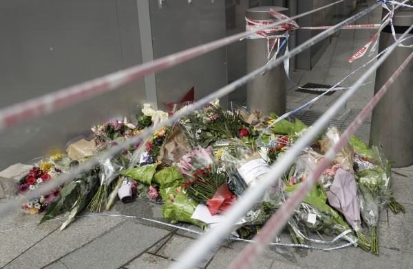A flower memorial for victims is placed under police tape in the London Bridge area of London