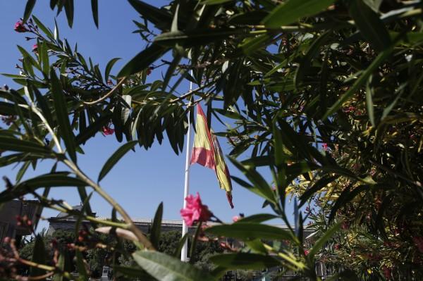 A Spanish flag flies at half staff