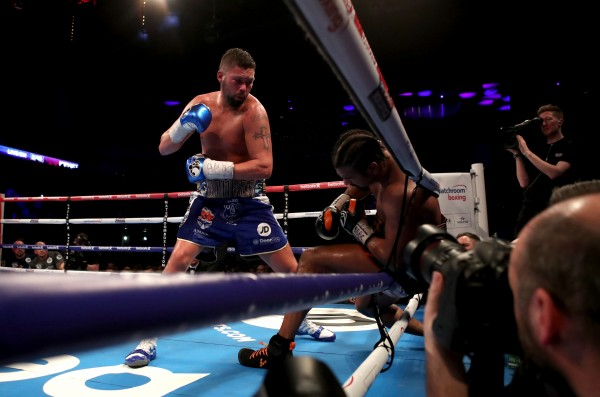 David Haye is knocked through the ropes by Tony Bellew