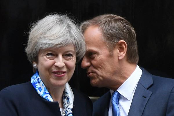 Theresa May greets Donald Tusk (Stefan Rousseau/PA)