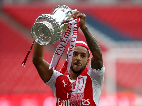 Arsenal's Theo Walcott lifts the FA Cup