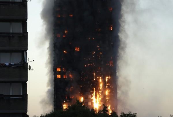 Smoke and flames rise from building (Matt Dunham/AP)