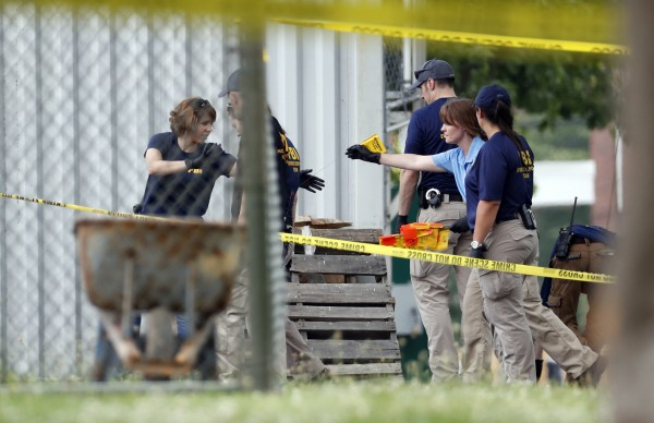 investigators on the scene of the shooting (Alex Brandon/AP)