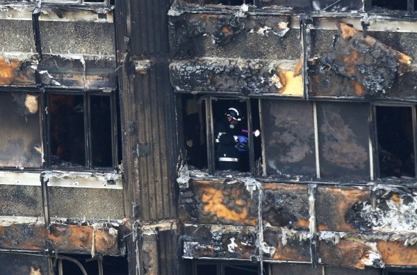 Fire service personnel survey the damage (Rick Findler/PA)