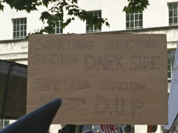 A sign at anti-Theresa May protests