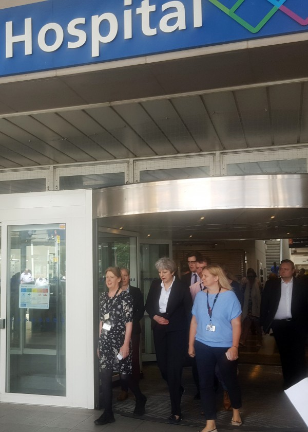 May leaves the Chelsea and Westminster Hospital in London after visiting people who were injured in the fire (Helen Williams/PA)