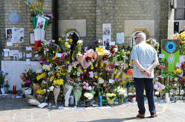 People lay flowers outside Notting Hill Methodist Church