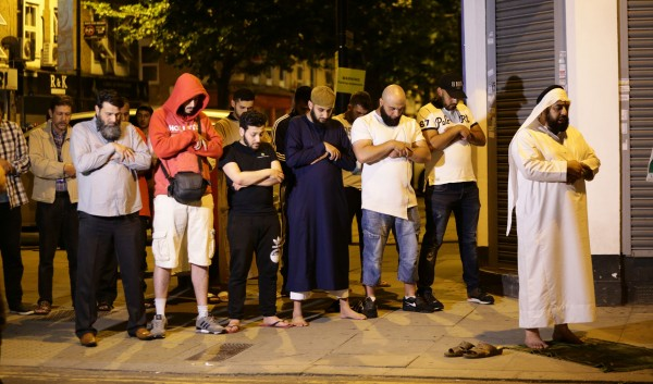 Local people observe prayers at Finsbury Park (Yui Mok/PA)