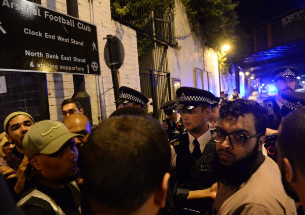 Police officers talk with local people at Finsbury Park (Yui Mok/PA)