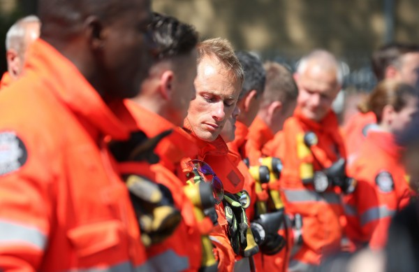 Members of the emergency services gather (Jonathan Brady/PA)