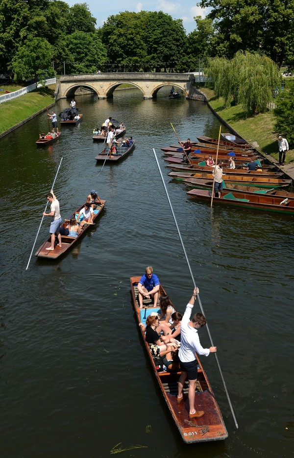 People relax in punts along the River Cam in Cambridge (Joe Giddens/PA)