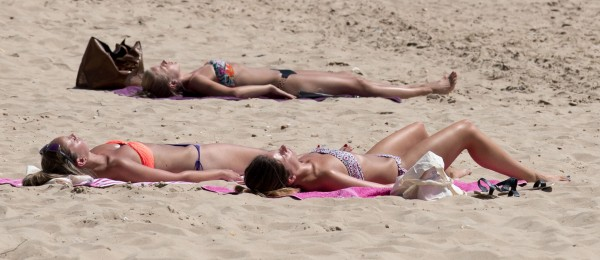 People enjoy the hot weather on the beach in Bournemouth