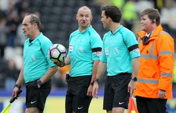 Match officials after a Premier League football match