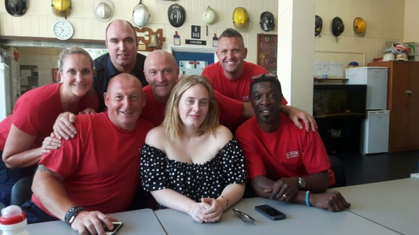 Adele with firefighters (London Fire Brigade)