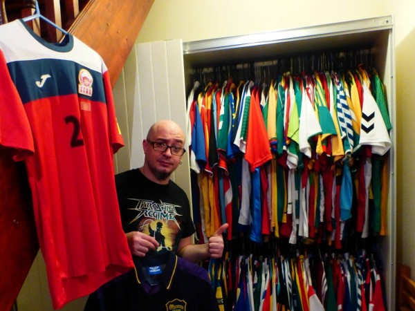 Joe Johnston with his football shirts