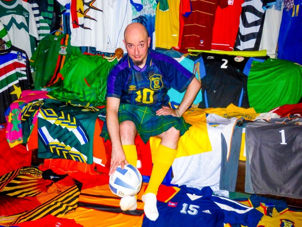 Joe Johnstone with his football shirt collection