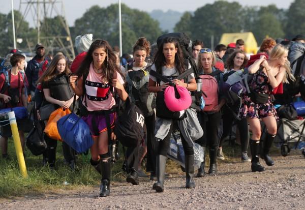 Festivalgoers arrive for the Glastonbury Festival at Worthy Farm in Pilton, Somerset (Yui Mok/PA)