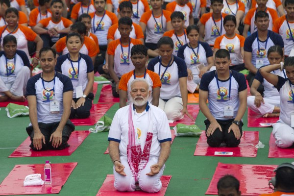 Prime Minister Modi performs yoga in Lucknow, India (Rajesh Kumar Singh/AP)