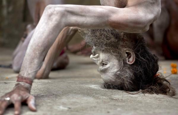 A Hindu holy man performs Yoga at Kamakhya temple in Gauhati, India (Anupam Nath/AP)