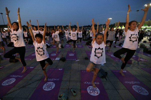 Children perform yoga to mark the International Day of Yoga in Seoul, South Korea (Ahn Young-joon/AP)