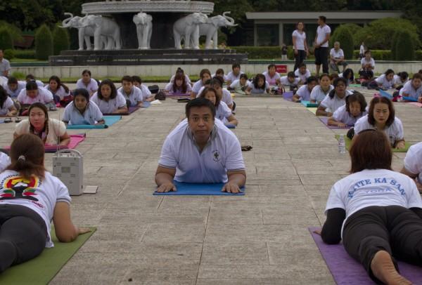 People practice yoga in Yangon, Myanmar (Thein Zaw/AP)