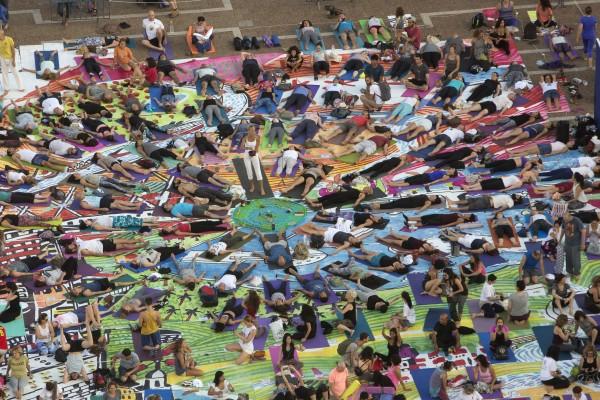 Israelis practice yoga at the Rabin square in Tel Aviv, Israel, Wednesday, June 21, 2017 (Sebastian Scheiner/AP)
