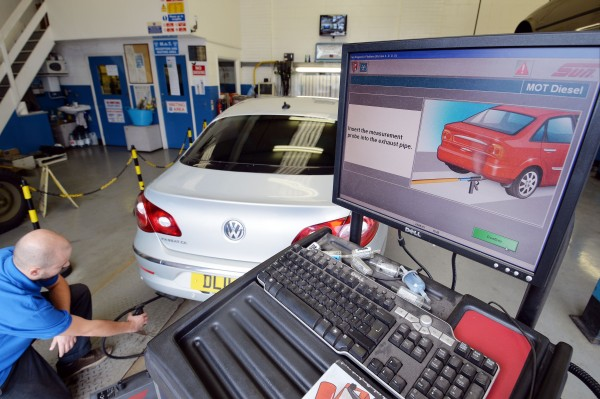 A Volkswagen Passat CC car is tested for its exhaust emissions, at a MOT (Ministry of Transport) testing station in Walthamstow, London (PA)